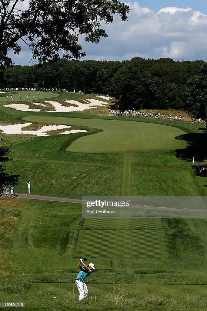 Nick Watney hits his tee shot on the fourth hole during the final round of The Barclays at the Black Course at Bethpage State Park August 26 2012 in...