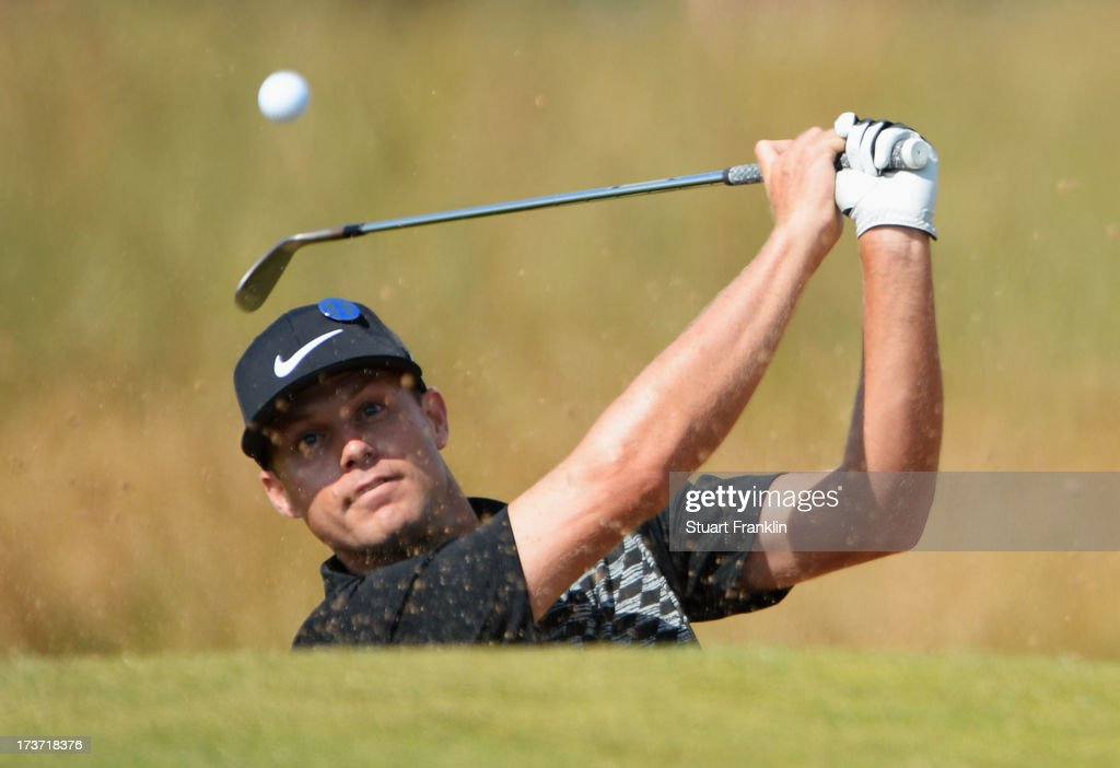 Nick Watney of the United States hits out of a bunker ahead of the 142nd Open Championship at Muirfield on July 17, 2013 in Gullane, Scotland.