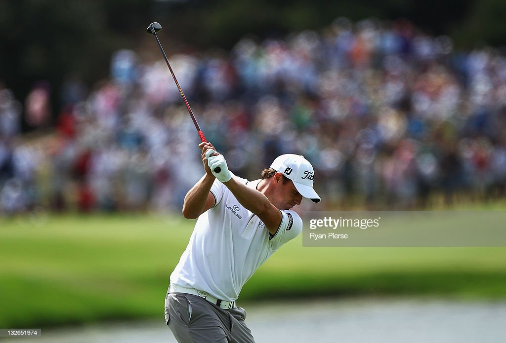 Nick Watney of the USA hits his second shot on the 11th Hole during day four of the 2011 Emirates Australian Open at The Lakes Golf Club on November...