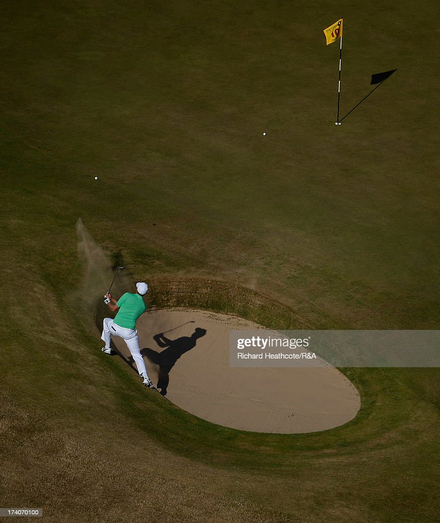 Nick Watney of the USA plays from a greenside bunker on the 10th during the second round of the 142nd Open Championship at Muirfield on July 19 2013...