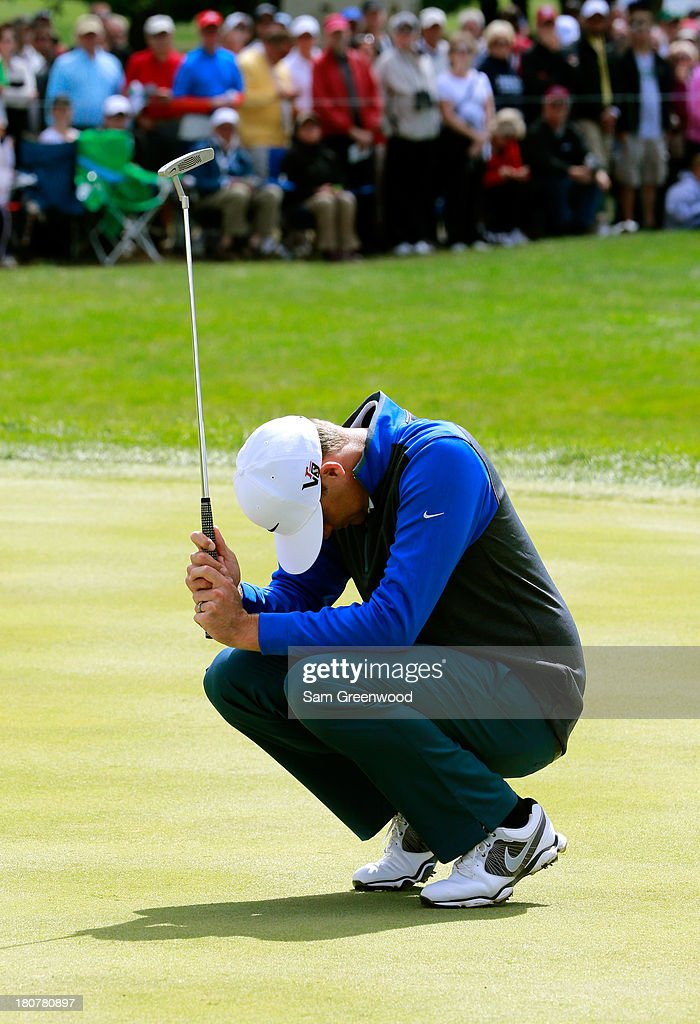 <a gi-track='captionPersonalityLinkClicked' href=/galleries/search?phrase=Nick+Watney&family=editorial&specificpeople=722428 ng-click='$event.stopPropagation()'>Nick Watney</a> reacts to a missed birdie putt on the 18th green during the Final Round of the BMW Championship at Conway Farms Golf Club on September 16, 2013 in Lake Forest, Illinois.