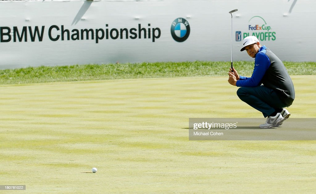 Nick Watney reacts to a missed birdie putt on the 18th green during the Final Round of the BMW Championship at Conway Farms Golf Club on September 16...