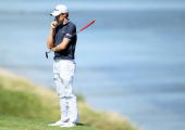 Nick Watney waits on the fourth green during the final round of the 92nd PGA Championship on the Straits Course at Whistling Straits on August 15...