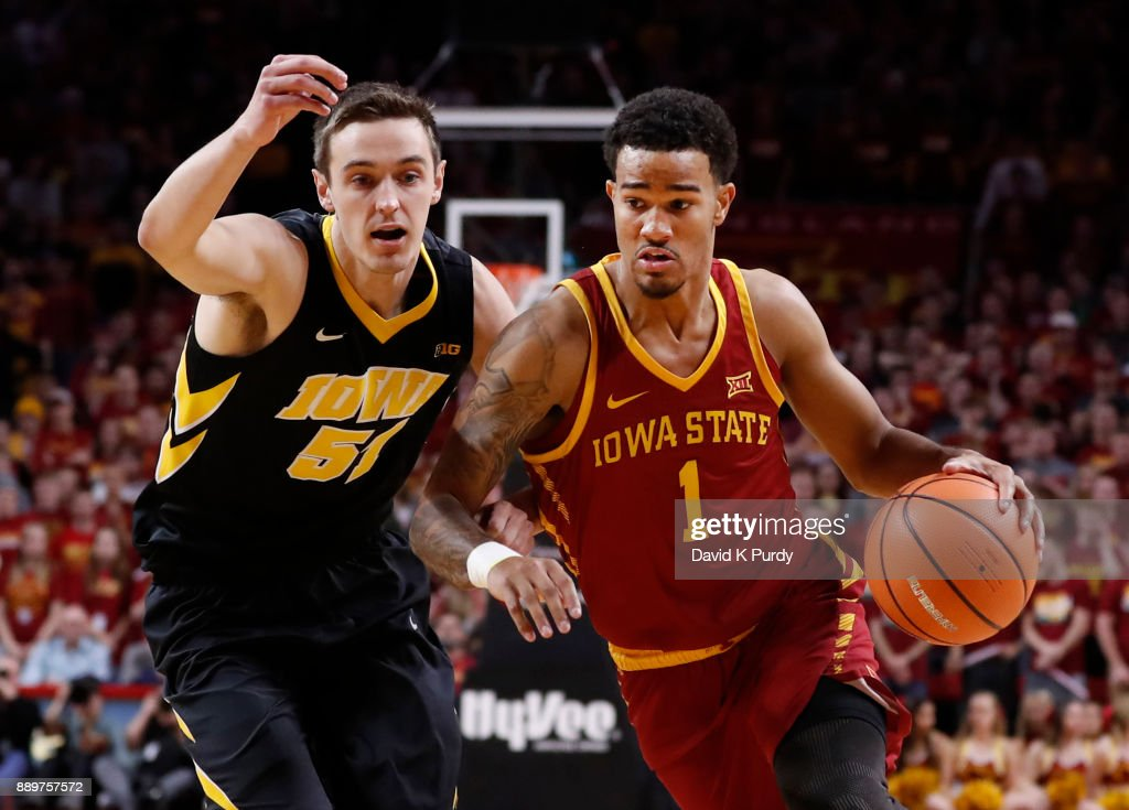 Nick Weiler-Babb #1 of the Iowa State Cyclones drives the ball as Nicholas Baer #51 of the Iowa Hawkeyes puts pressure on in the first half of play at Hilton Coliseum on December 7, 2017 in Ames, Iowa.