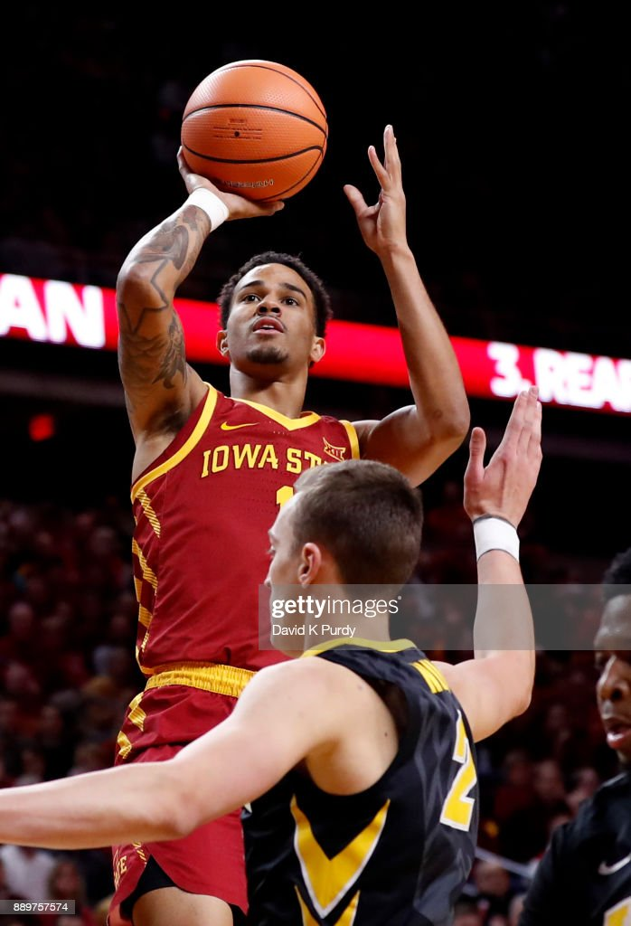 Nick Weiler-Babb #1 of the Iowa State Cyclones takes a shot over Jack Nunge #2 of the Iowa Hawkeyes in the first half of play at Hilton Coliseum on December 7, 2017 in Ames, Iowa.