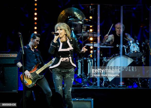 Nick Wilkinson Chrissie Hynde and Martin Chambers of rock group Pretenders performing live on stage at the Royal Albert Hall in London on April 10...