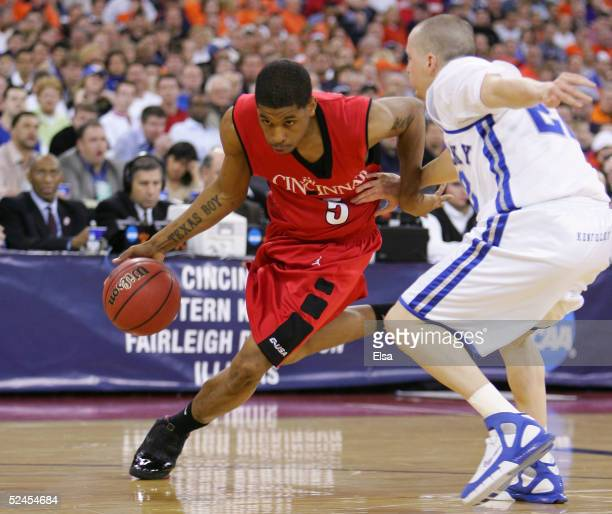 Nick Williams of the Cincinnati Bearcats drives against Patrick Sparks of the Kentucy Wildcats in the second round game of the NCAA Division I Men's...