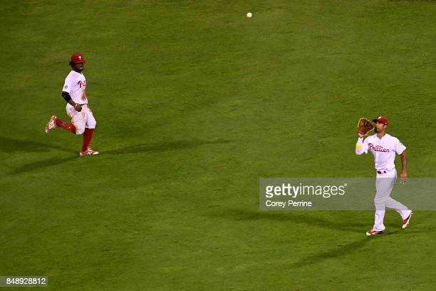 Nick Williams of the Philadelphia Phillies catches a pop fly as teammate Odubel Herrera looks on against the Oakland Athletics during the eighth...