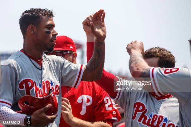 Nick Williams of the Philadelphia Phillies is congratulated by teammates after scoring a run against the San Francisco Giants during the second...