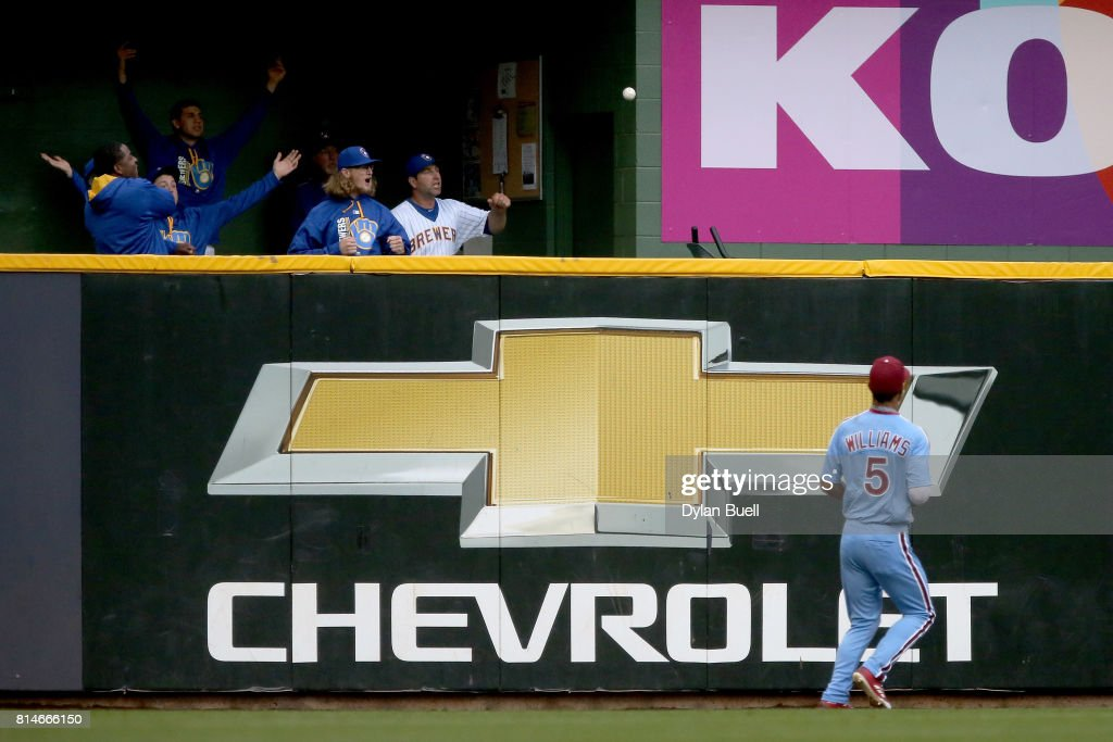 Nick Williams #5 of the Philadelphia Phillies looks on as a ball hit by Orlando Arcia #3 of the Milwaukee Brewers flies over the fence for a home run in the second inning at Miller Park on July 14, 2017 in Milwaukee, Wisconsin.