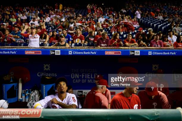 Nick Williams of the Philadelphia Phillies looks up as a raucous crowd dances against the Oakland Athletics before the continuation of the third...