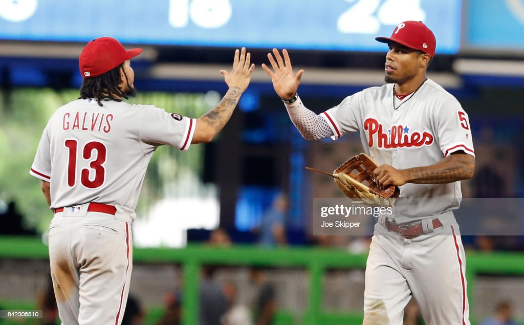 Nick Williams #5 of the Philadelphia Phillies, right, celebrates with Freddy Galvis #13 after their 12 inning 3-1 win over the Miami Marlins at Marlins Park on September 3, 2017 in Miami, Florida.