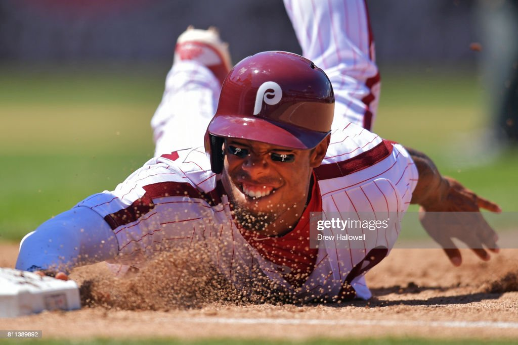Nick Williams #5 of the Philadelphia Phillies slides into first base on a pick off play in the fourth inning against the San Diego Padres at Citizens Bank Park on July 9, 2017 in Philadelphia, Pennsylvania.
