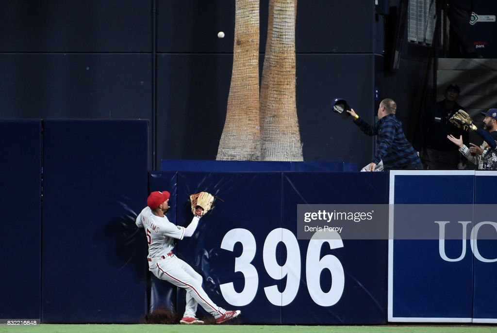 Nick Williams #5 of the Philadelphia Phillies watches a solo home run hit by Cory Spangenberg #15 of the San Diego Padres go over the wall during the fourth inning of a baseball game at PETCO Park on August 15, 2017 in San Diego, California.