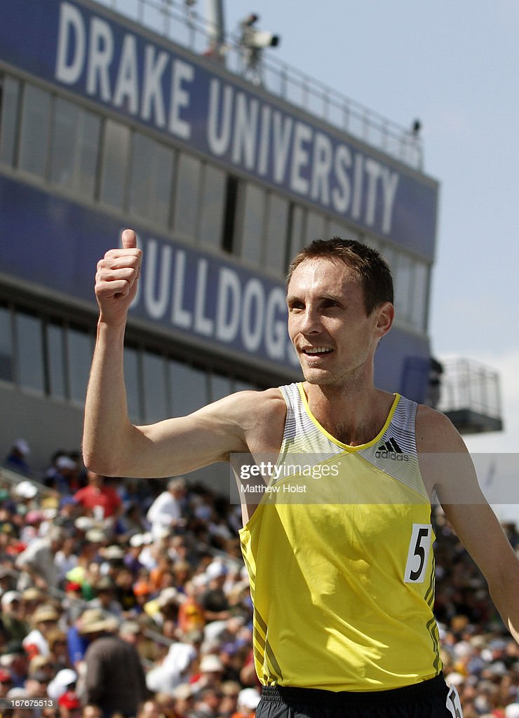 Nick Willis, of New Zealand, acknowledges the crowd after winning the Men's Special Mile Run at the Drake Relays, on April 27, 2013 at Drake Stadium, in Des Moines, Iowa.