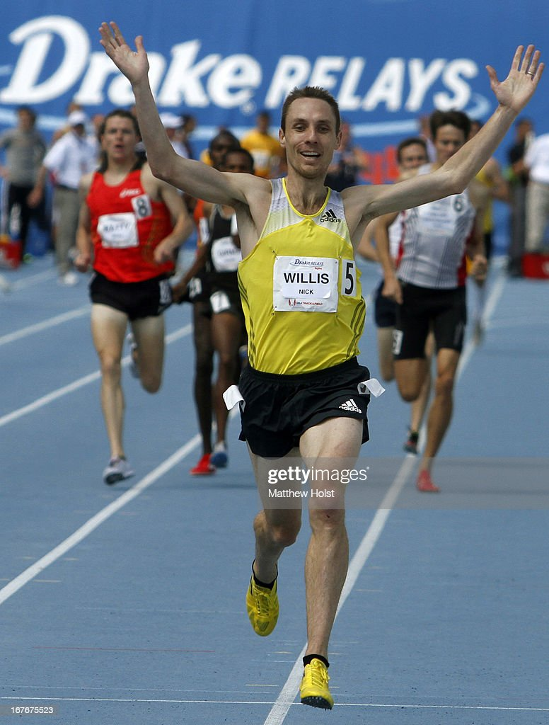 Nick Willis, of New Zealand, celebrates as he crosses the finish line to win the Men's Special Mile Run at the Drake Relays, on April 27, 2013 at Drake Stadium, in Des Moines, Iowa.