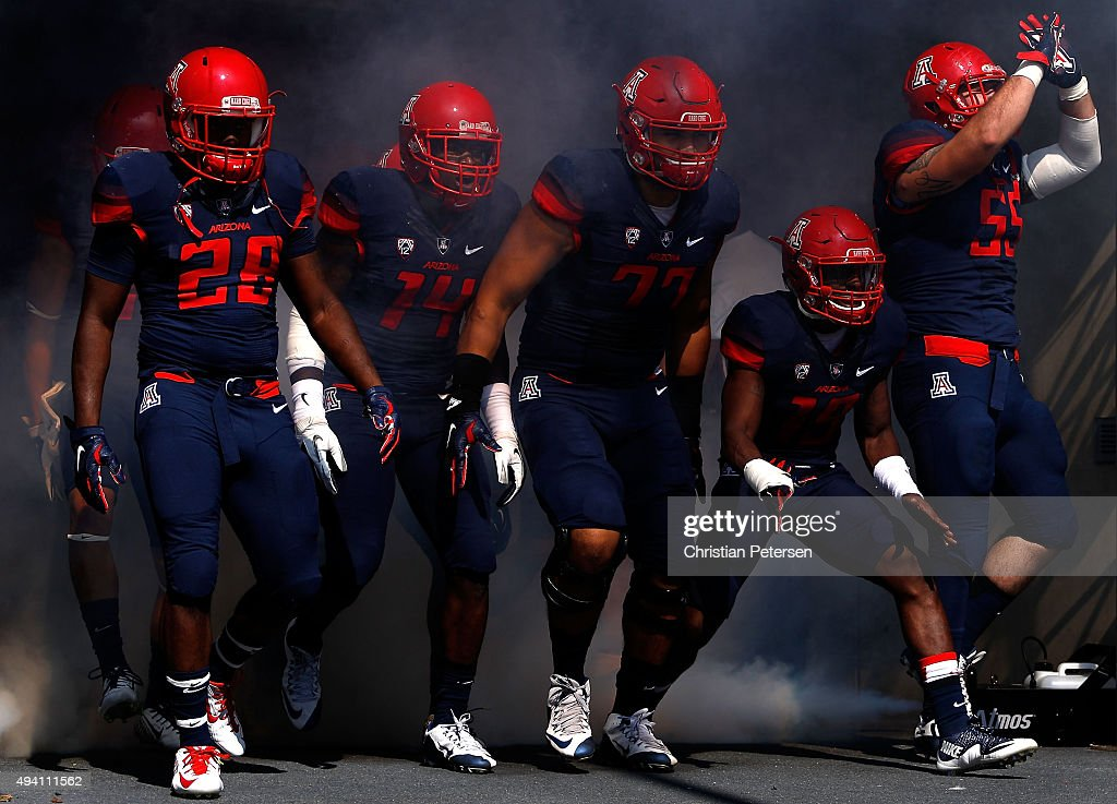 Nick Wilson #28, Paul Magloire Jr. #14, Lene Maiava #77, DaVonte' Neal #19 and Jeff Worthy #55 of the Arizona Wildcats take the field during introductions to the college football game against the Washington State Cougars at Arizona Stadium on October 24, 2015 in Tucson, Arizona. The Cougars defeated the Wildcats 45-42.