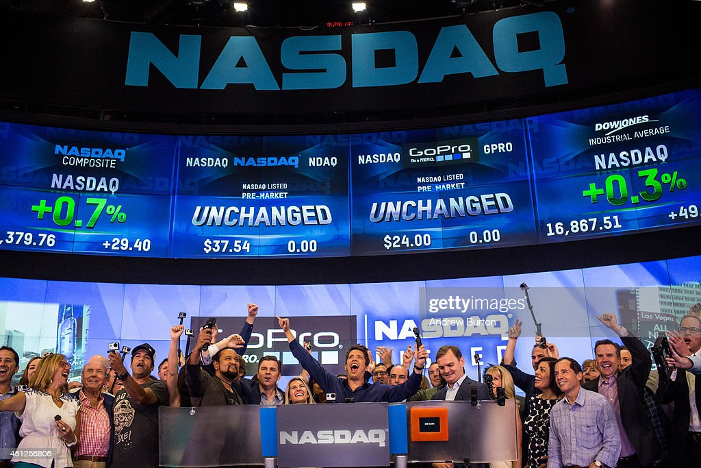 Nick Woodman founder and CEO of GoPro and the GoPro team celebrate during the company's initial public offering at the Nasdaq Stock Exchange on June...