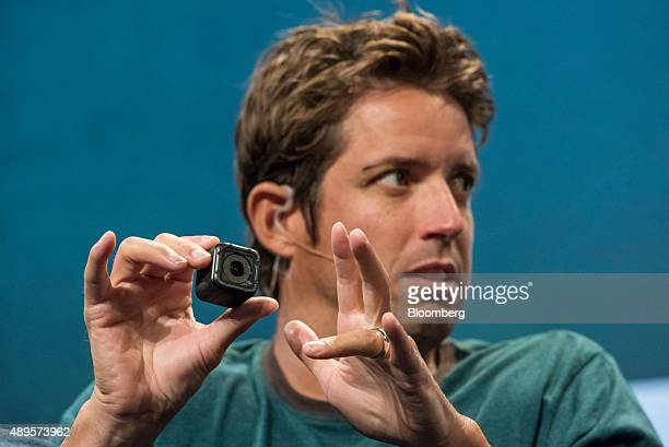 Nick Woodman founder and chief executive officer of GoPro Inc holds the new GoPro HERO4 Session camera while speaking during the TechCrunch Disrupt...
