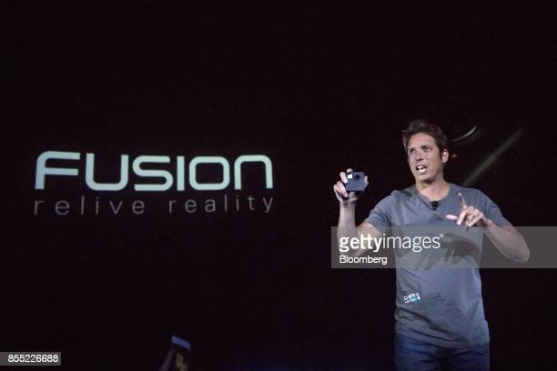 Nick Woodman founder and chief executive officer of GoPro Inc holds the Fusion 360 camera while speaking during an event in San Francisco California...