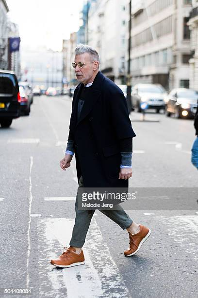 Nick Wooster enters the Pringle of Scotland show in New Balance x Grenson shoes during The London Collections Men AW16 at The Reform Club on January...