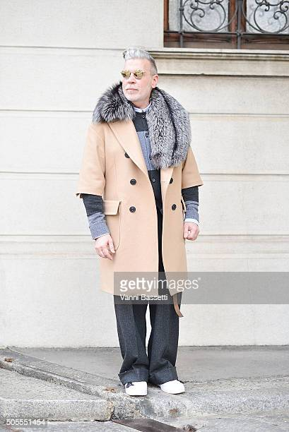 Nick Wooster poses wearing a Nick Wooster X Lardini coat before the Etro show during the Milan Men's Fashion Week Fall/Winter 2016/17 on January 18...