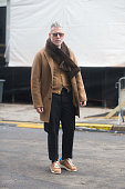 Nick Wooster wears wears a Kolor jacket Mark McNairy scarf Brooks Brothers vest and pants and Adidas sneakers and Garrett Leigh sunglasses at Streets...