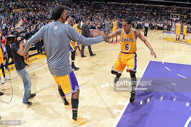 Nick Young and Jordan Clarkson of the Los Angeles Lakers shake hands during warm ups before the game against the Golden State Warriors on November 4...
