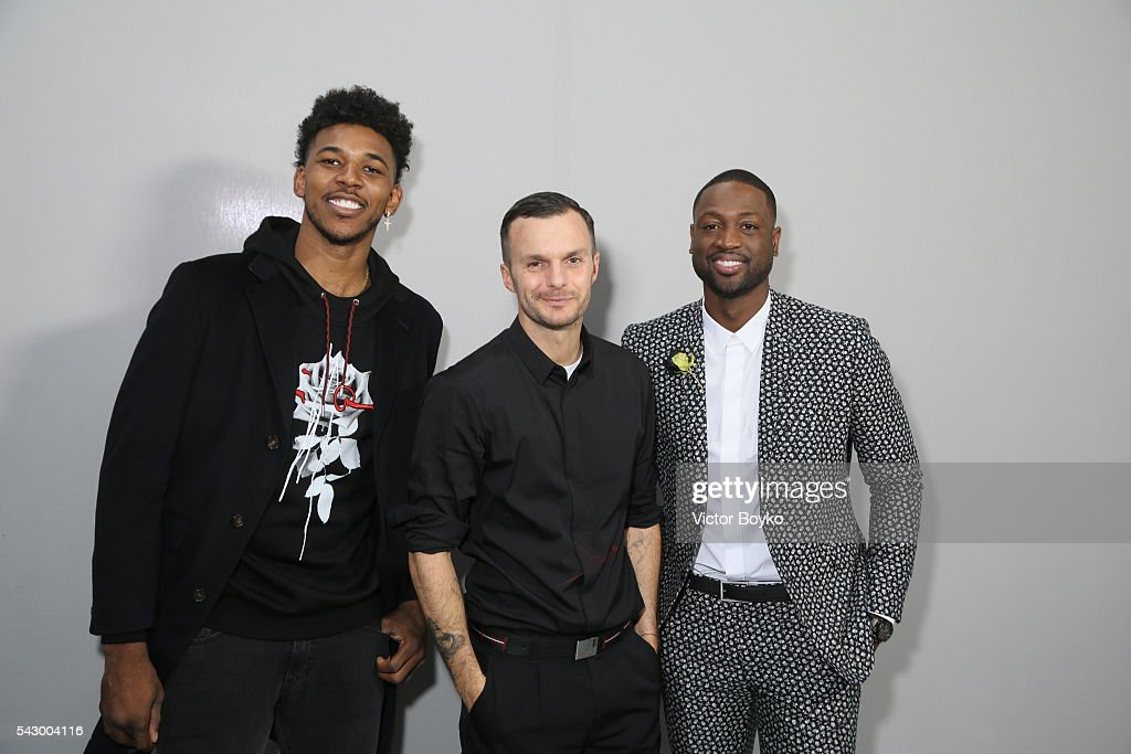 Nick Young, Kris Van Assche and Dwyane Wade backstage pose in the backstage before the Dior Homme Menswear Spring/Summer 2017 show as part of Paris Fashion Week on June 25, 2016 in Paris, France.