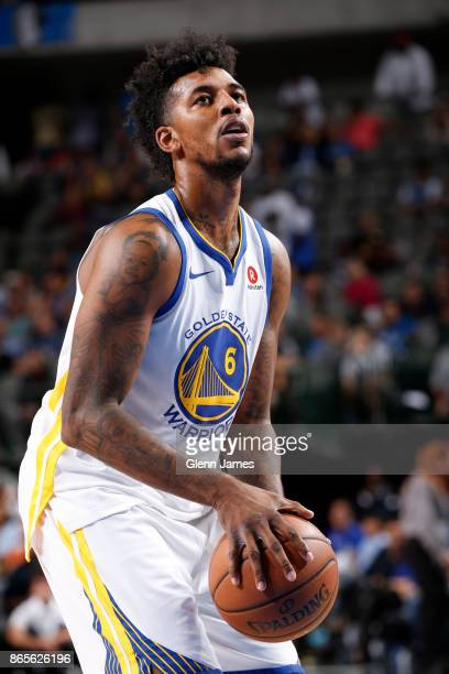 Nick Young of the Golden State Warriors handles the ball against the Dallas Mavericks on October 23 2017 at the American Airlines Center in Dallas...