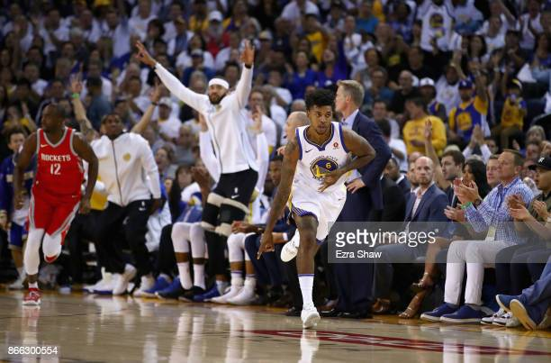 Nick Young of the Golden State Warriors reacts after making a basket against the Houston Rockets at ORACLE Arena on October 17 2017 in Oakland...