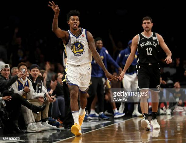 Nick Young of the Golden State Warriors reacts after making a three point shot in the second quarter against the Brooklyn Nets during their game at...