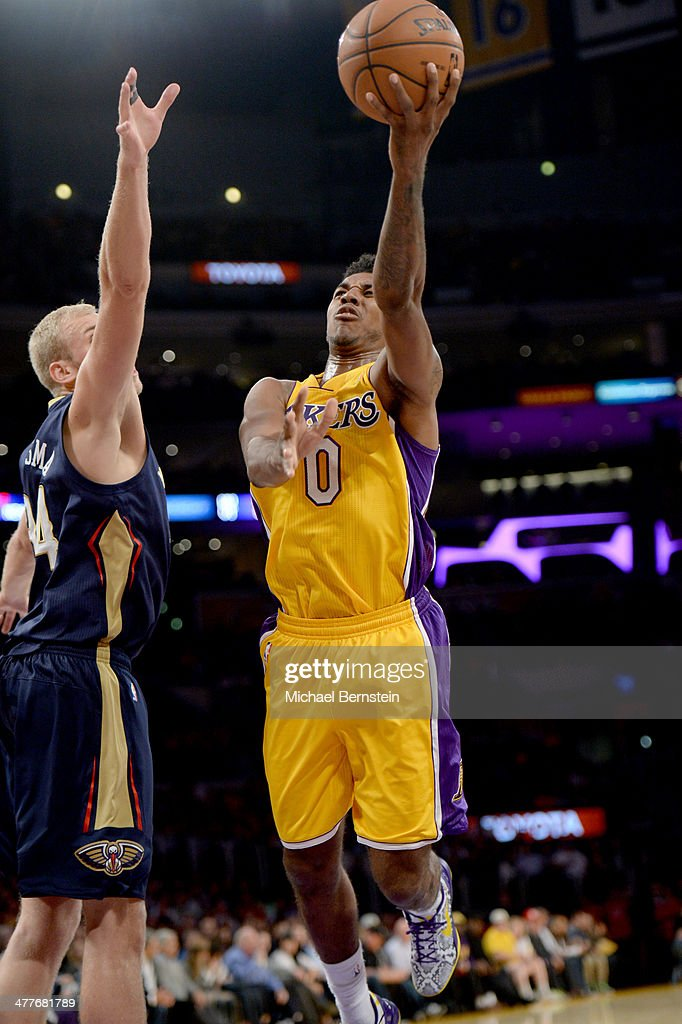 Nick Young #0 of the Los Angeles Lakers attempts a shot against the New Orleans Pelicans at Staples Center on November 12, 2013 in Los Angeles, California.