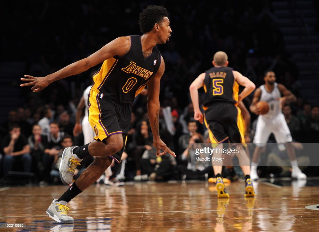 Nick Young #0 of the Los Angeles Lakers celebrates a three point basket during the second half against the Brooklyn Nets at Barclays Center on November 27, 2013 in the Brooklyn borough of New York City. The Lakers defeat the Nets 99-94.