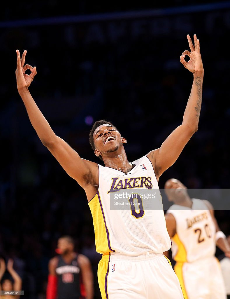 Nick Young #0 of the Los Angeles Lakers celebrates after a three point basket by Jodie Meeks #20 in the fourth quarter against the Detroit Pistons at Staples Center on November 17, 2013 in Los Angeles, California. The Lakers 2on 114-99.