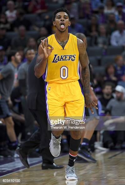 Nick Young of the Los Angeles Lakers celebrates after making a threepoint basket against the Sacramento Kings during an NBA basketball game at Golden...