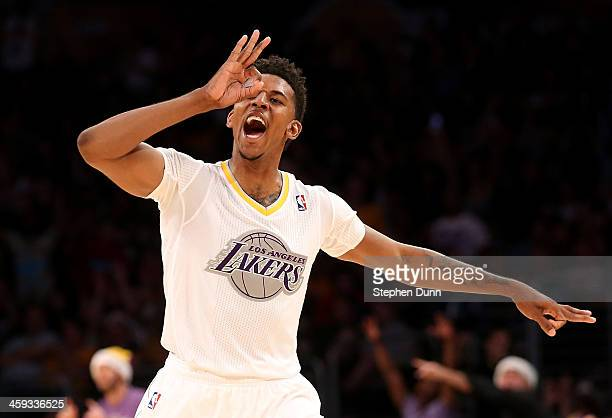 Nick Young of the Los Angeles Lakers celebrates after making a three point basket against the Miami Heat at Staples Center on December 25 2013 in Los...