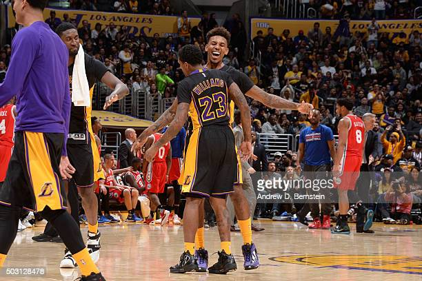 Nick Young of the Los Angeles Lakers celebrates with Louis Williams of the Los Angeles Lakers during the game against the Philadelphia 76ers on...
