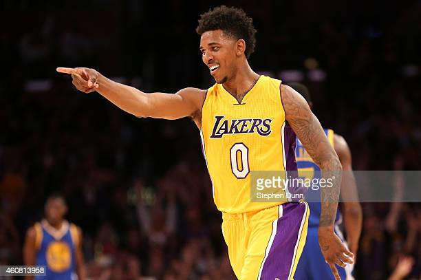 Nick Young of the Los Angeles Lakers points to a teammate after making a three point shot against the Golden State Warriors at Staples Center on...