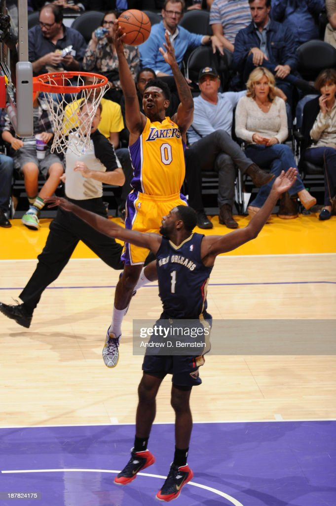 Nick Young #0 of the Los Angeles Lakers shoots against Tyreke Evans #1 of the New Orleans Pelicans at Staples Center on November 12, 2013 in Los Angeles, California.