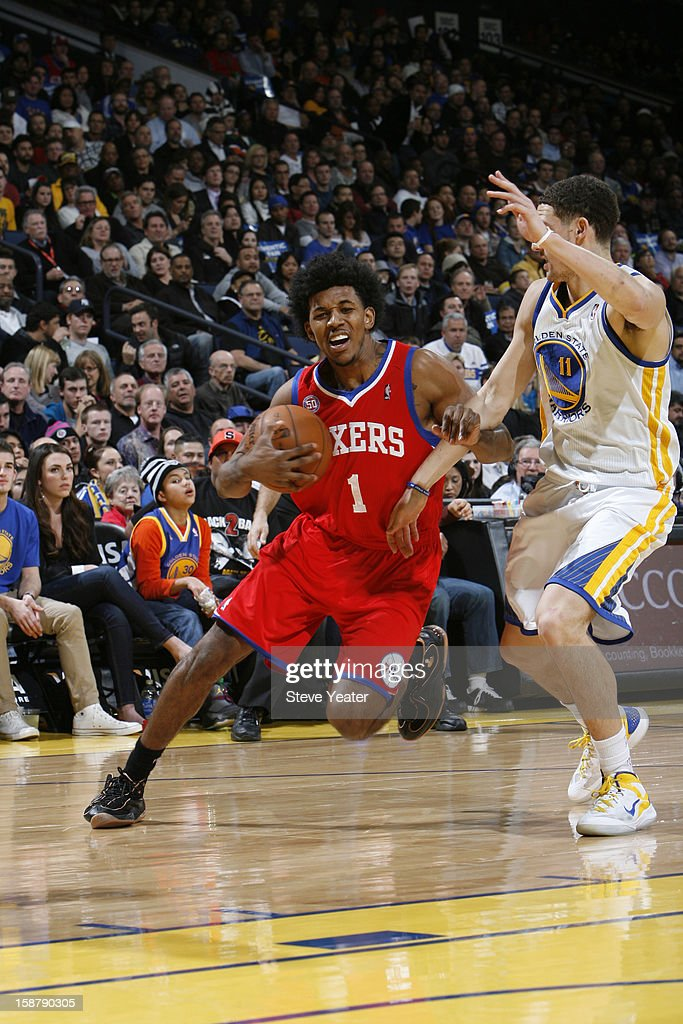 Nick Young #1 of the Philadelphia 76ers drives to the basket against <a gi-track='captionPersonalityLinkClicked' href=/galleries/search?phrase=Klay+Thompson&family=editorial&specificpeople=5132325 ng-click='$event.stopPropagation()'>Klay Thompson</a> #11 of the Golden State Warriors on December 28, 2012 at Oracle Arena in Oakland, California.