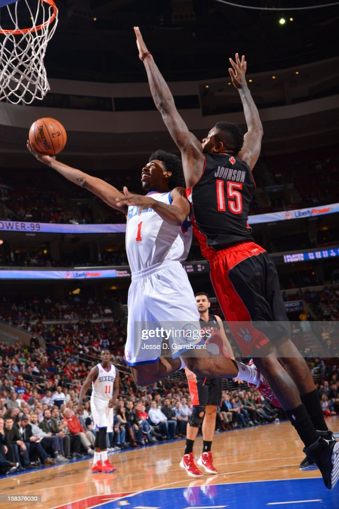 Nick Young #1 of the Philadelphia 76ers drives to the basket past <a gi-track='captionPersonalityLinkClicked' href=/galleries/search?phrase=Amir+Johnson&family=editorial&specificpeople=556786 ng-click='$event.stopPropagation()'>Amir Johnson</a> #15 of the Toronto Raptors at the Wells Fargo Center on November 20, 2012 in Philadelphia, Pennsylvania.