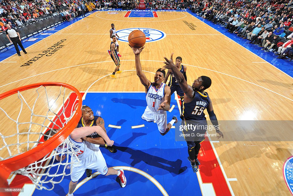 Nick Young #1 of the Philadelphia 76ers goes to the basket against <a gi-track='captionPersonalityLinkClicked' href=/galleries/search?phrase=Roy+Hibbert&family=editorial&specificpeople=725128 ng-click='$event.stopPropagation()'>Roy Hibbert</a> #55 of the Indiana Pacers during the game at the Wells Fargo Center on February 6, 2013 in Philadelphia, Pennsylvania.