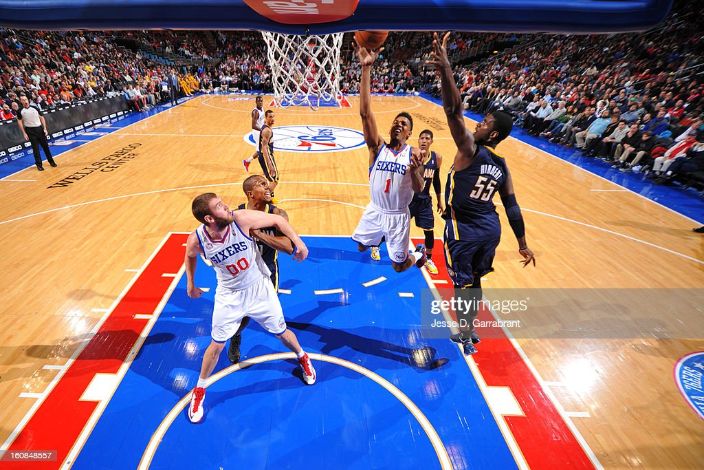 Nick Young #1 of the Philadelphia 76ers shoots a layup against <a gi-track='captionPersonalityLinkClicked' href=/galleries/search?phrase=Roy+Hibbert&family=editorial&specificpeople=725128 ng-click='$event.stopPropagation()'>Roy Hibbert</a> #55 of the Indiana Pacers during the game at the Wells Fargo Center on February 6, 2013 in Philadelphia, Pennsylvania.