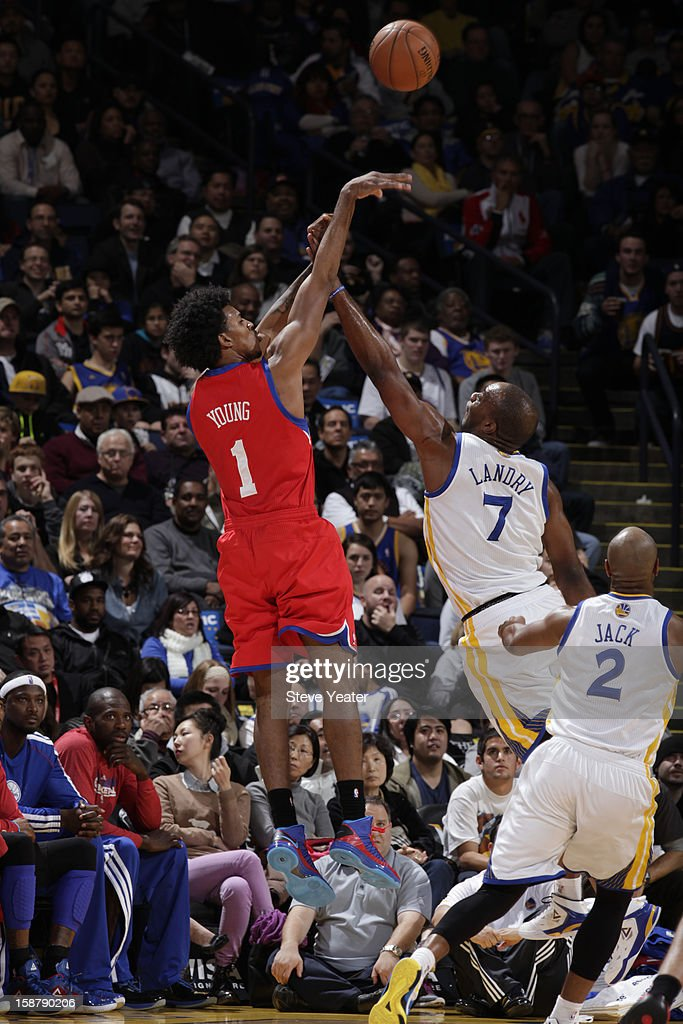 Nick Young #1 of the Philadelphia 76ers shoots against <a gi-track='captionPersonalityLinkClicked' href=/galleries/search?phrase=Carl+Landry&family=editorial&specificpeople=4111952 ng-click='$event.stopPropagation()'>Carl Landry</a> #7 of the Golden State Warriors on December 28, 2012 at Oracle Arena in Oakland, California.
