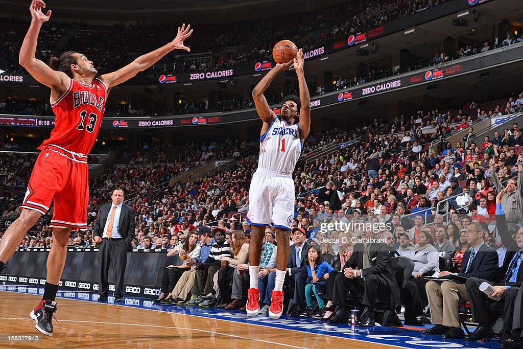 Nick Young #1 of the Philadelphia 76ers shoots against <a gi-track='captionPersonalityLinkClicked' href=/galleries/search?phrase=Joakim+Noah&family=editorial&specificpeople=699038 ng-click='$event.stopPropagation()'>Joakim Noah</a> #13 of the Chicago Bulls on December 12, 2012 at the Wells Fargo Center in Philadelphia, Pennsylvania.