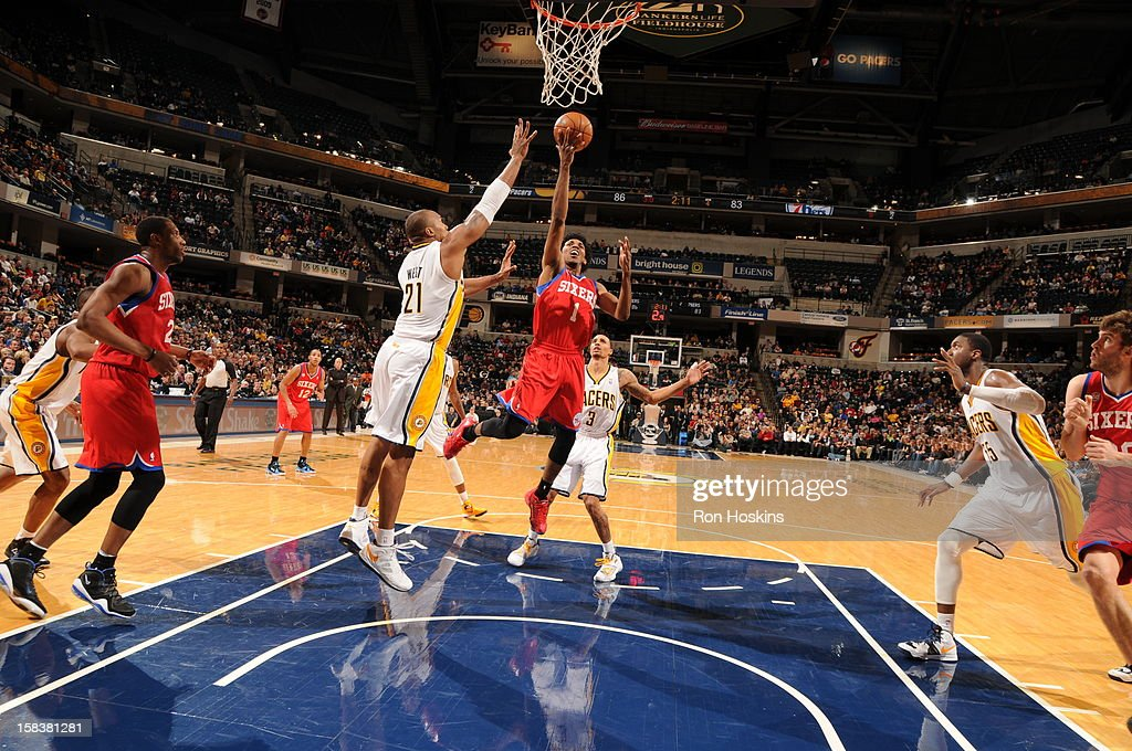 Nick Young #1 of the Philadelphia 76ers shoots the ball against David West #21 of the Indiana Pacers on December 14, 2012 at Bankers Life Fieldhouse in Indianapolis, Indiana.