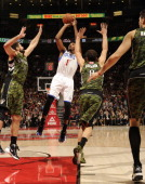 Nick Young of the Philadelphia 76ers shoots the ball over Linas Kleiza and Jose Calderon of the Toronto Raptors during the game on November 10 2012...