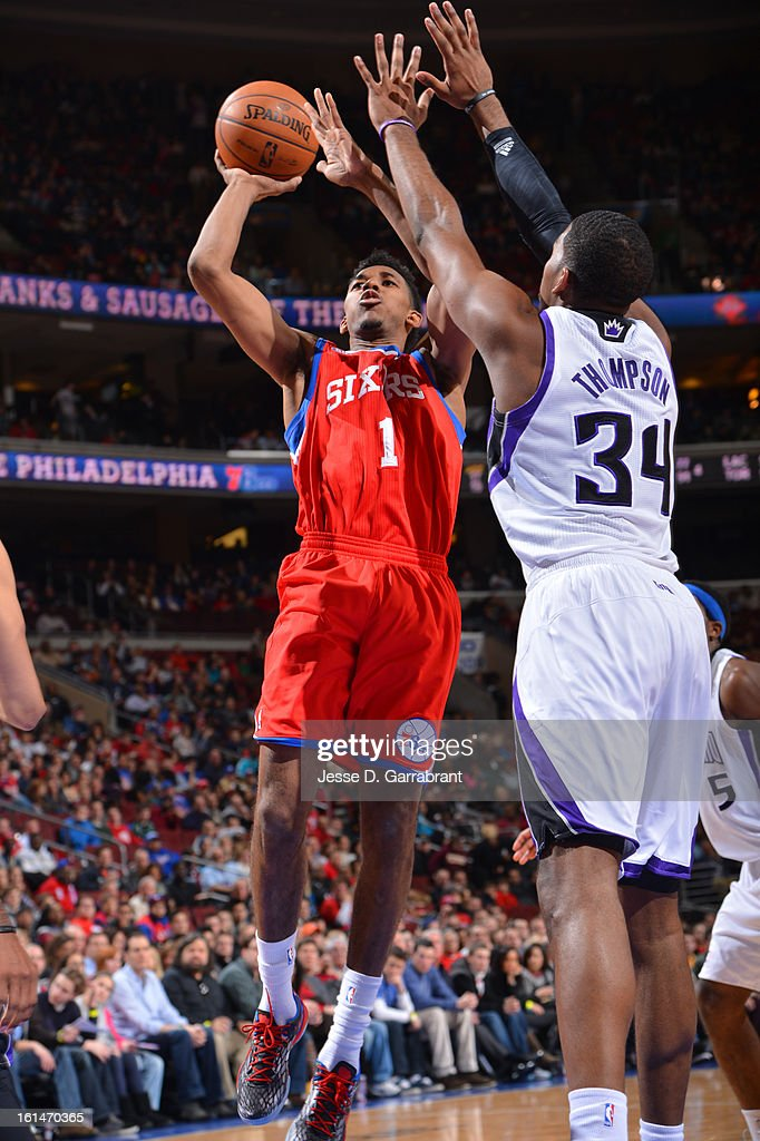 Nick Young #1 of the Philadelphia 76ers takes a shot against Jason Thompson #34 of the Sacramento Kings during the game at the Wells Fargo Center on February 1, 2013 in Philadelphia, Pennsylvania.