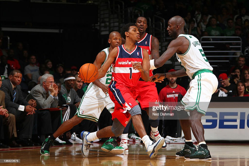 Nick Young #1 of the Washington Wizards drives against <a gi-track='captionPersonalityLinkClicked' href=/galleries/search?phrase=Kevin+Garnett&family=editorial&specificpeople=201473 ng-click='$event.stopPropagation()'>Kevin Garnett</a> #5 of the Boston Celtics during the game at the Verizon Center on January 1, 2012 in Washington, DC.